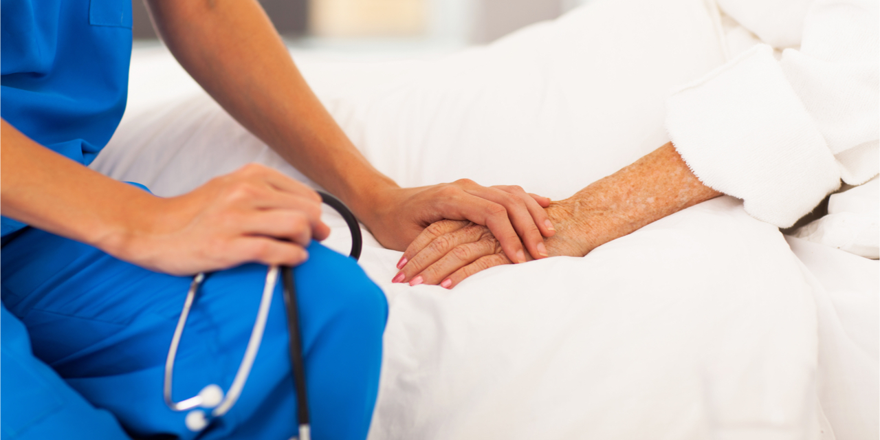 A caring nurse caring for her patient.