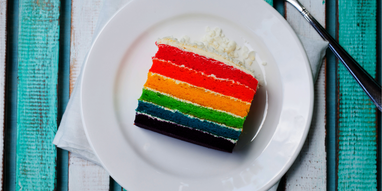 Colorful slice of wedding cake.