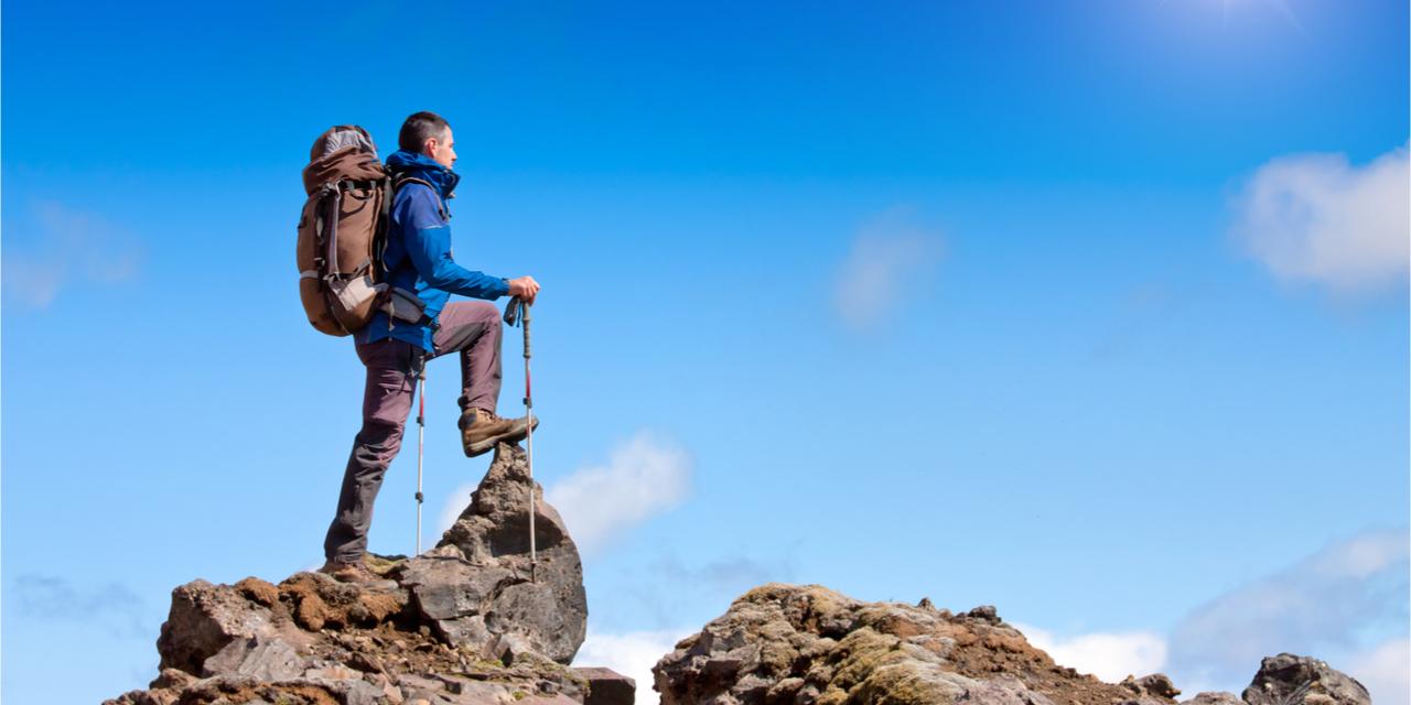 A guy on a mountain, enjoying a benevolent universe.