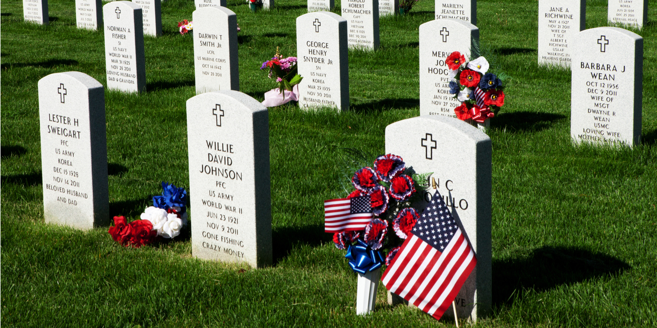 Gravestones with American Flags on Memorial Day