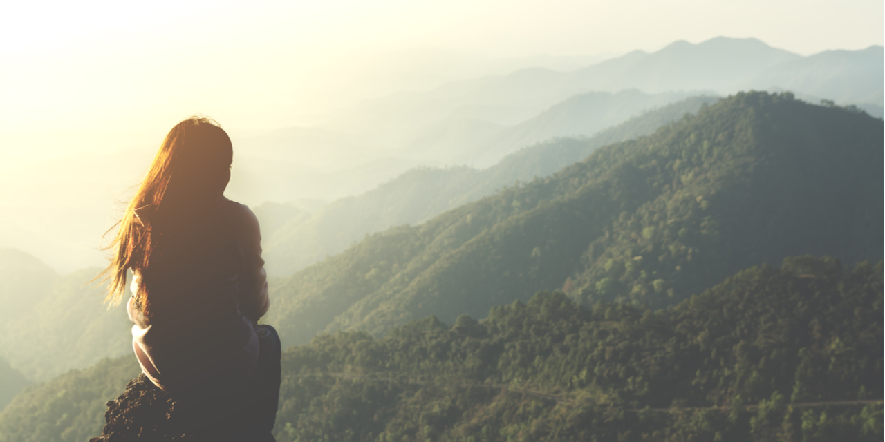 Woman looking out at mountains