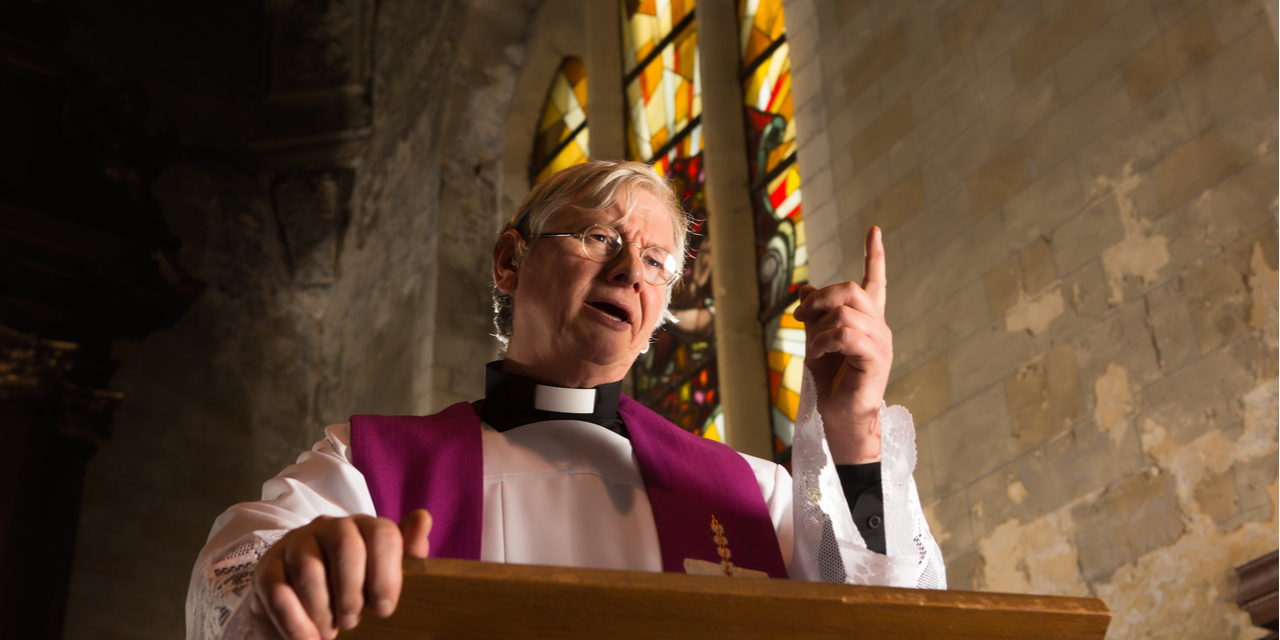 Priest in pulpit delivering sermon