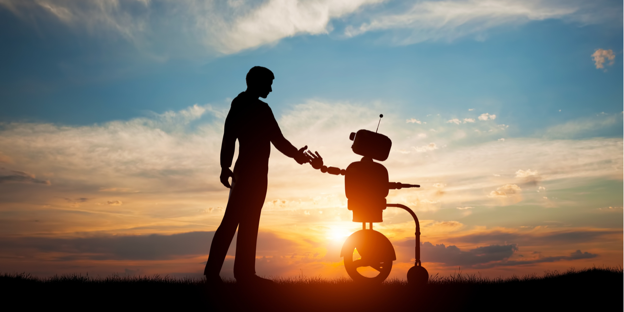 Man and robot at sunset