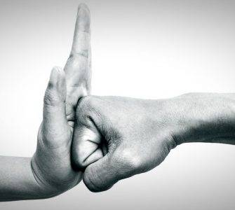 Fist hitting open hand