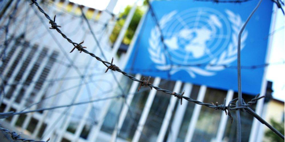 United Nations flag and barbed wire