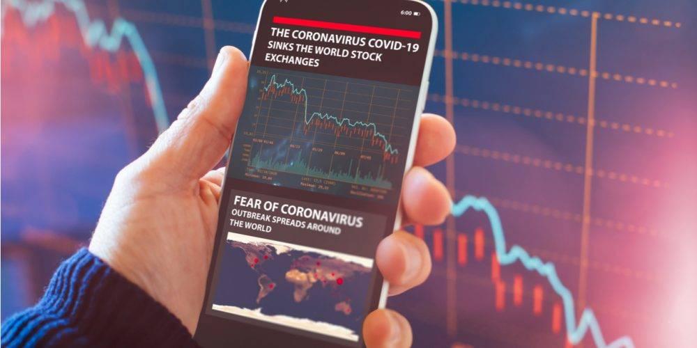 Smartphone showing coronavirus stock market crash