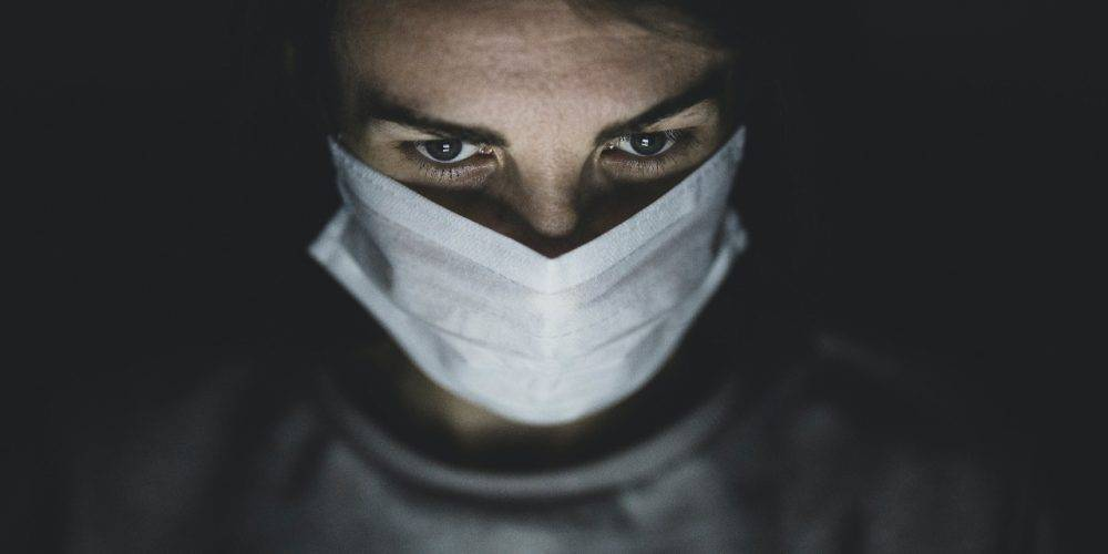 Photo of man in surgical mask by Engin Akyurt from Pexels