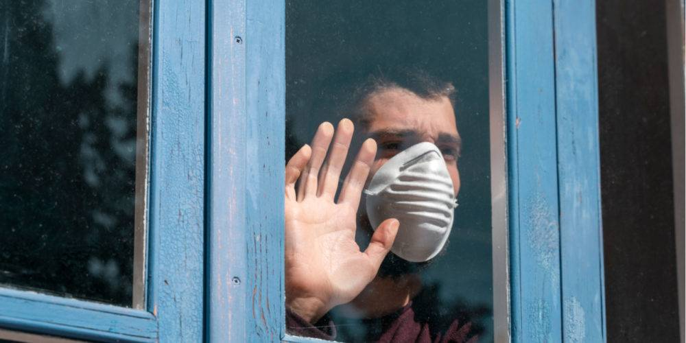 Man with mask at window