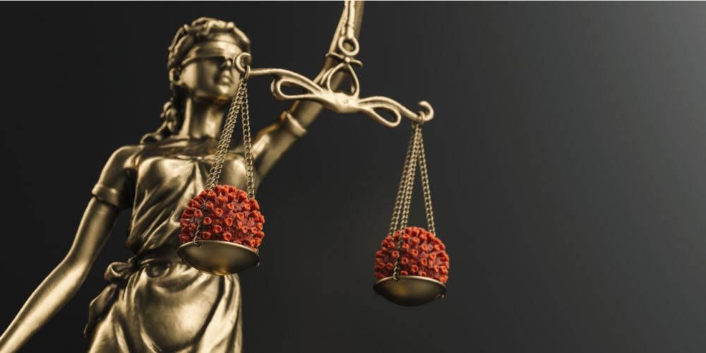 Justice statue weighing coronavirus