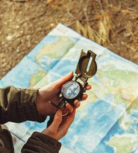 Woman using compass with map
