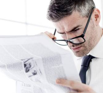 Man reading news AR hit pieces