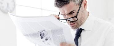 Man reading news AR hit pieces