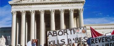 Abortion placards Supreme Court steps