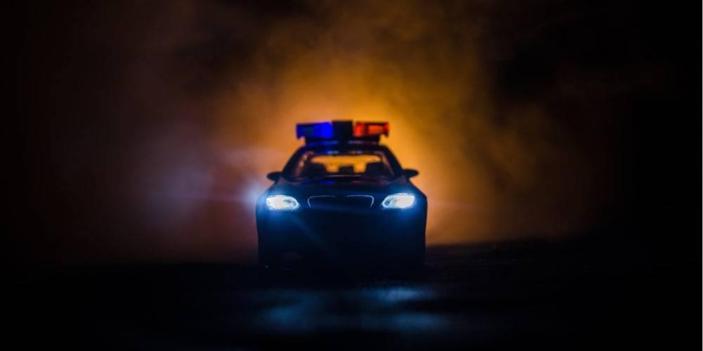 Police car menacing fog