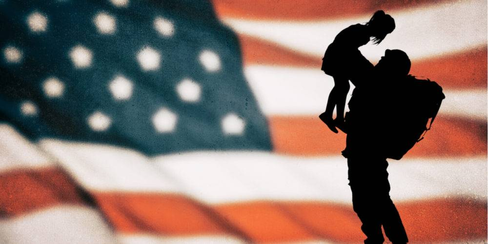 American flag background, soldier holding up little girl - shutterstock_368985278