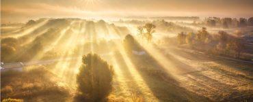 Sun spilling across fields
