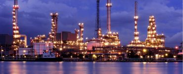 Oil refinery at night near water