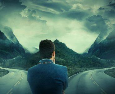 Man choosing between two roads