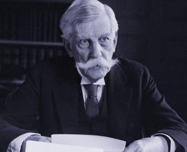 Justice Holmes at desk (blue)